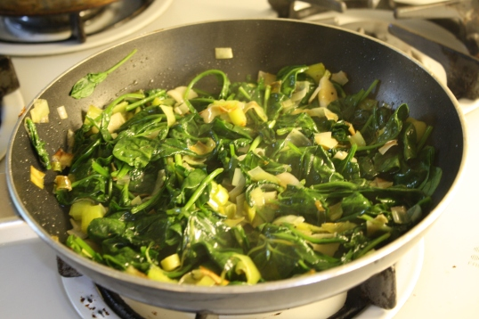 Stir spinach into onions until wilted.